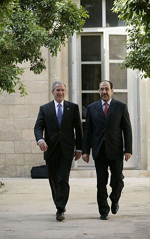 "Foreign policy of the George W. Bush administration - President George W. Bush walks with Iraqi Prime Minister Nouri al-Maliki at the U.S. Embassy in Baghdad, Iraq, June 13, 2006. During his unannounced trip to Iraq, President Bush thanked the Prime Minister, telling him, ""I'm convinced you will succeed, and so will the world."""