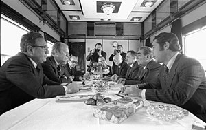Vladivostok Summit Meeting on Arms Control - The American and Soviet delegations in conversation aboard a Soviet train en route to Okeanskaya