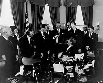 Estes Kefauver - After signing the 1962 Drug Control Act into law, President John Kennedy presents the pen to Senator Kefauver
