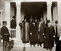 President Theodore Roosevelt and David R. Francis leaving the Sweden Building on Roosevelt Day at the 1904 World's Fair, 26 November 1904.jpg