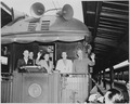 President and Mrs. Harry S. Truman, Margaret Truman, and two unidentified men standing on the rear platform of the... - NARA - 199961.tif