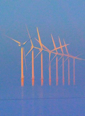 English: Off shore wind turbines bathed in mis...