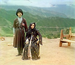 A couple in traditional dress poses for a portrait in Dagestan. Photographed by Sergey Prokudin-Gorsky, circa 1907 to 1915.
