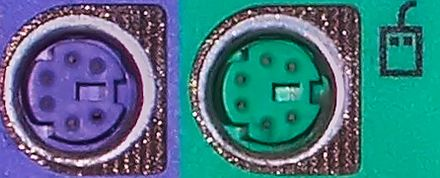 Color-coded PS/2 connection ports; purple for keyboard and green for mouse Ps-2-ports.jpg