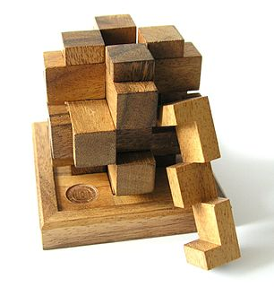 Mechanical puzzle puzzle presented as a set of mechanically interlinked pieces