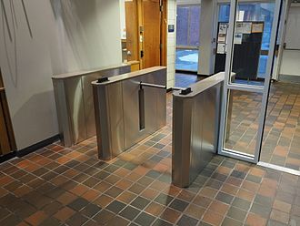 Access control - Drop Arm Optical Turnstiles Manufactured by Q-Lane Turnstiles LLc