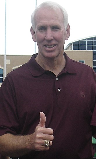 R. C. Slocum - Slocum gives a gig 'em with his Big 12 Championship ring
