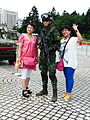 ROC Airborne Special Operations Forces Soldier with Two Women Photographing on Square 20140607.jpg