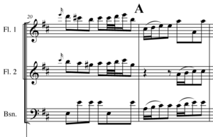 """Rehearsal letter - From a page in the full score of Christoph Graupner's Symphony in D major, Nagel 75. If the conductor wants to resume rehearsal from the second measure shown here, he could either say """"measure 21"""" or """"letter A""""."""