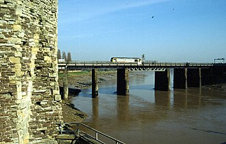 Newport Castle - Trains pass near to the castle on the railway bridge crossing the River Usk