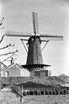ronde stenen stellingmolen vanaf de maasdijk gezien - wijk en aalburg - 20003182 - rce