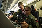 Sailor demonstrates the surveillance and reconnaissance capablities of the P-8A Poseidon aircraft to Royal Thai Navy Chief Petty. (32653224160).jpg