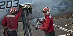 Sailors download rounds from an F-A-18E Super Hornet aboard USS Carl Vinson 141028-N-TP834-530.jpg
