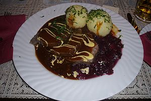 Pot roast - Image: Sauerbraten with potato dumplings