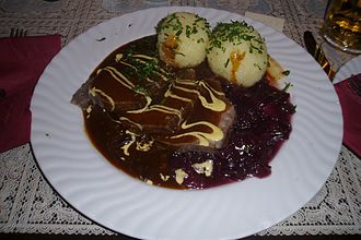 Pot roast - Image: Sauerbraten with potato dumplings