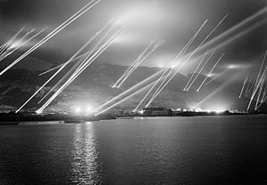 Searchlight - Searchlights pierce the night sky during an air-raid practice on Gibraltar, 1942