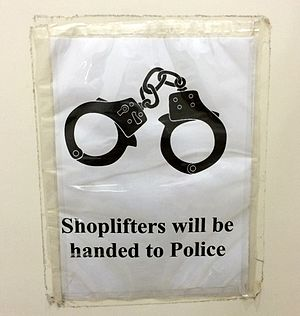 Shoplifting - Notice warning shoplifters of prosecution in Subang Parade, Malaysia.