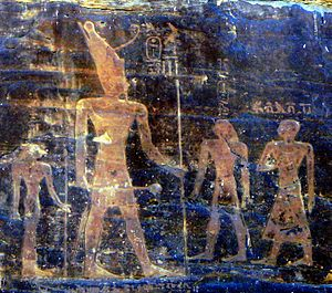 Mentuhotep II - Silsileh rock relief depicting a giant king Mentuhotep II, on the right Intef III and the treasurer Kheti and, on the left, queen Iah.