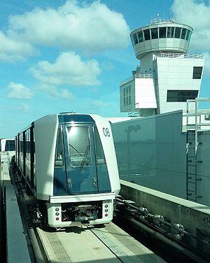 Skytrain (Miami International Airport) - Skytrain leaving Station 3 near control tower.