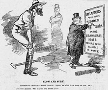 A cartoon; see description. The uitlander is depicted as towering over Kruger, who has to stand on a ledge to reach the sign he is pointing to explaining the franchise law.