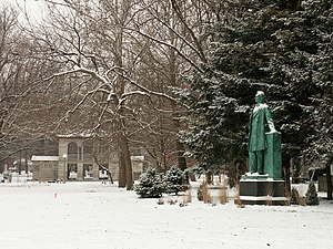 A snowy day in Carle Park west of Urbana High School. On the right is a statue of Abraham Lincoln by Lorado Taft.
