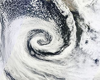 Low-pressure area - A clockwise spinning low pressure area or cyclone off southern Australia. The center of the spiral-shaped cloud system is also the center of a low, and usually is where the pressure is lowest.