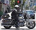 Speeding off on a motorcycle sfpd, san francisco (2012) (7457336170).jpg