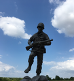Statue of soldier from US 103rd Division.png