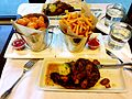 Steak meal with fries and tater tots.JPG