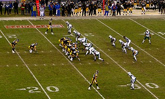 I formation - This is an example of an I formation in an NFL game.  The Pittsburgh Steelers (black and yellow) are set in the I formation with one tight end and two wide receivers. The New York Jets (white and green) are lined up in a 4-3 defensive formation.