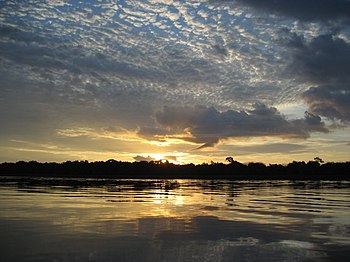 English: Sunrise on the Congo River near Mossa...