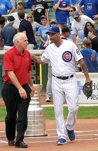 Dale Sveum - Sveum  pictured right as Cubs manager in 2013 with Blackhawks coach Joel Quenneville
