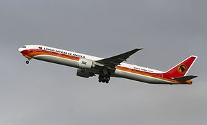 TAAG Angola Airlines - A Boeing 777-300ER takes off from Lisbon Portela Airport in 2012.