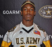 American football player in a hat and jersey both with US Army insignia.