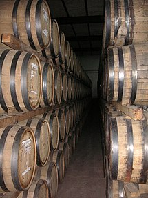 Tequila being rested or aged in oak barrels