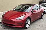 Tesla Model 3 parked, front driver side.jpg
