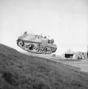 Universal Carrier - A Universal Carrier of 52nd Reconnaissance Regiment catches air on manoeuvres, Scotland, 10 November 1942
