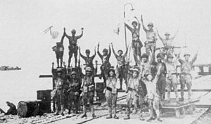 The Japanese 2d Division celebrates landing at Merak.jpg