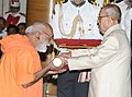 The President, Shri Pranab Mukherjee presenting the Padma Bhushan Award to Swami Dayananda Saraswati (Posthumous), at a Civil Investiture Ceremony, at Rashtrapati Bhavan, in New Delhi on April 12, 2016.jpg