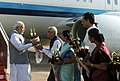 The Prime Minister, Shri Narendra Modi being received by the Governor of Gujarat, Shri O.P. Kohli and the Chief Minister of Gujarat, Smt. Anandiben Patel on his arrival, at Ahmadabad airport, in Gujarat on January 10, 2015.jpg