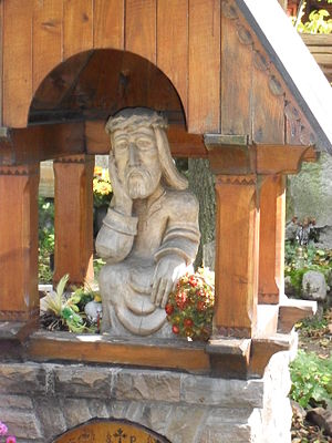 English: A wooden carving of the contemplative...