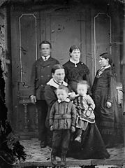 Three women, a young man and two children