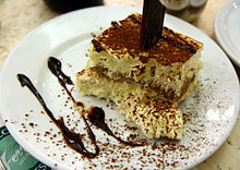 Tiramisu with cholocate sauce at Ferrara in Little Italy, New York City.jpg