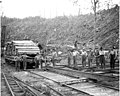 Track crew and railroad ties on flatbed moving car, Camp 5, English Lumber Company, ca 1917 (KINSEY 152).jpeg