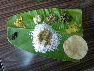 Cuisine of Kerala - A traditional home-made Keralite meal served on a banana leaf.