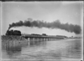 "Train hauled by a ""Wg"" class steam locomotive crossing bridge over Waikareao Estuary, Tauranga ATLIB 314652.png"
