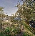 Tuin met op de achtergrond warenhuis en druivenserre - Monster - 20405797 - RCE.jpg