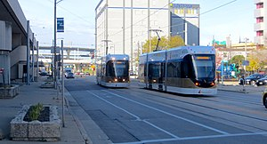 Two Hop streetcars passing on St Paul Ave east of 4th in Nov. 2018.jpg