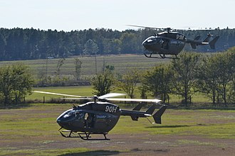 Eurocopter UH-72 Lakota - Two UH-72As trainers maneuvering on the ground near each other.