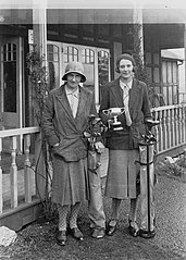 Two ladies in front of the Llandrindod Wells Golf Club pavilion